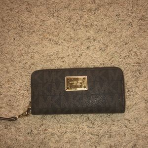 Brown Michael Kors MK wristlet wallet